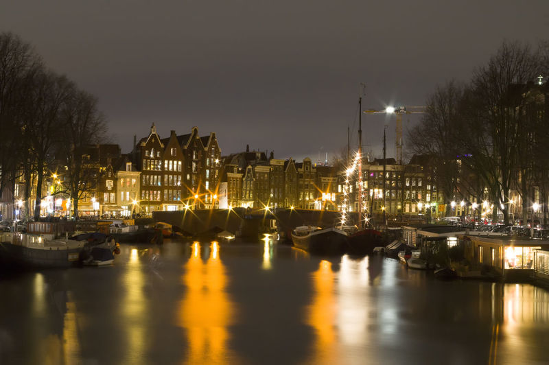 Amsterdam view by night Amsterdam By Night Long Exposure Longexposure Long Time Exposure Nightphotography Reflections In The Water Amsterdam City Cityscape Illuminated Sky Architecture Historic Arch Bridge Light Painting Light Trail Reflection Urban Skyline