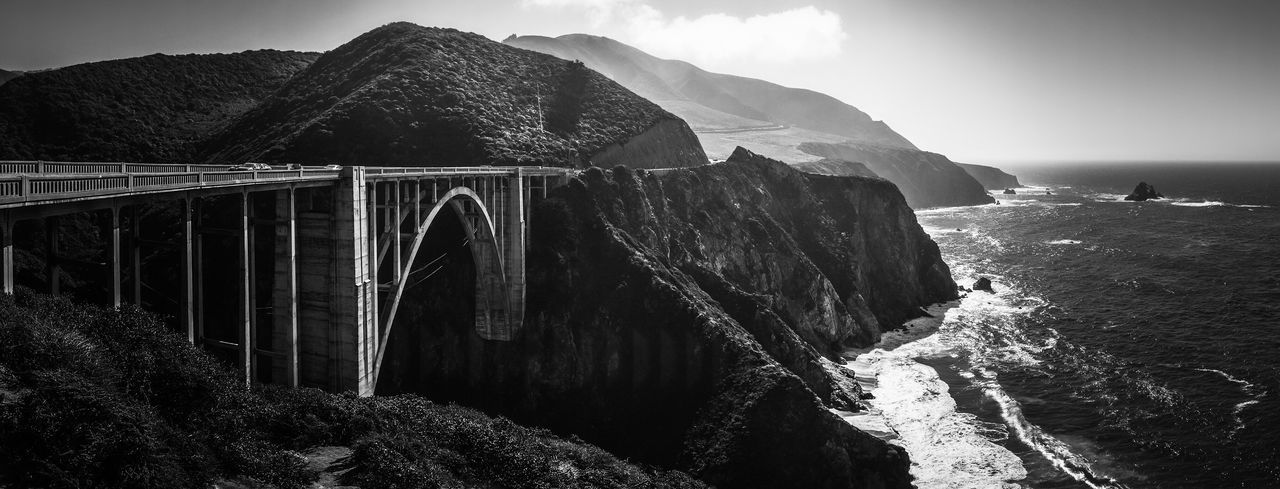 Bridge - Man Made Structure Water Mountain Connection Outdoors Built Structure Beauty In Nature Sky Sea Travel Destinations Pacific California Ocean EyeEm Nature Lover EyeEmNewHere Rocky Shore Coast Waves Landscape Panorama Bridge Bixby Bridge Big Sur Bixby Bridge Pacific Coast Highway Coastal Highway The Great Outdoors - 2017 EyeEm Awards