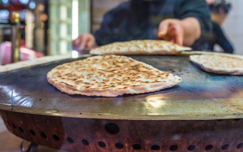 turkish gozleme and sac closeup at cooking with staff in the background Cuisine Dinner Food And Drink Gözleme Snack Spicy Staff Tradition Turkey Bread Culture Food Food And Drink Freshness Hotplate Human Body Part Kebab Kitchen People Preparation  Real People Sac Selective Focus Traditional Turkish Visual Creativity #urbanana: The Urban Playground A New Beginning The Art Of Street Photography