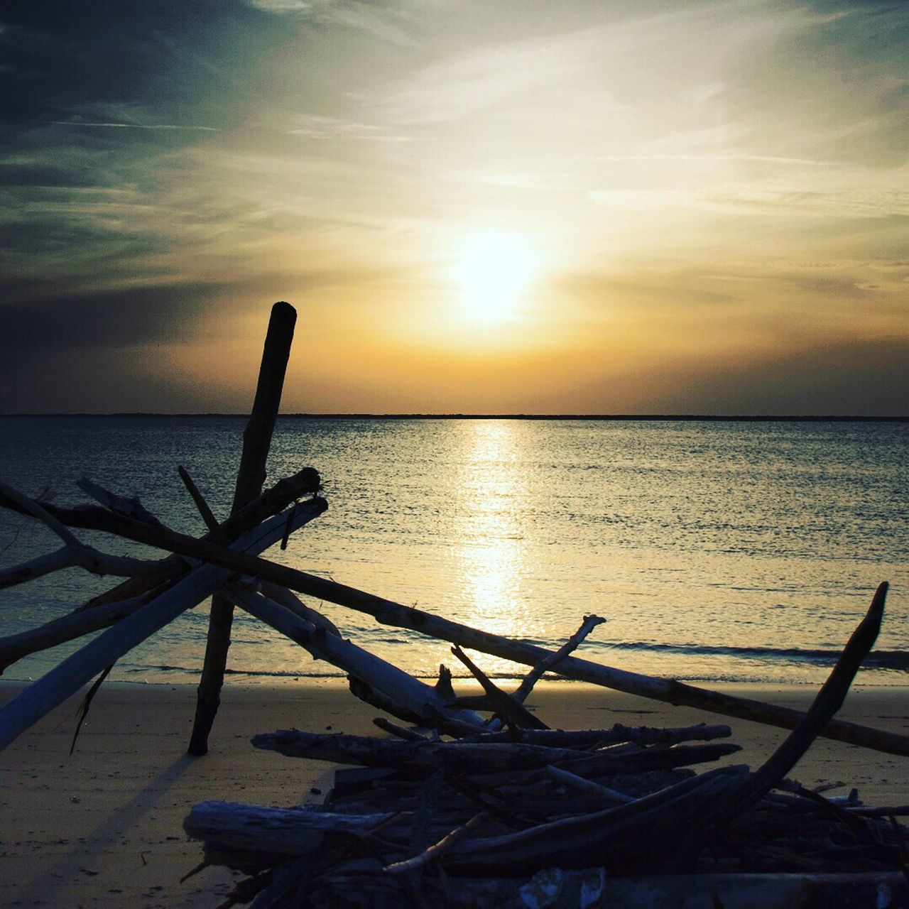 sunset, sea, horizon over water, scenics, beauty in nature, beach, water, sky, tranquility, nature, tranquil scene, no people, sun, cloud - sky, sunlight, outdoors, day