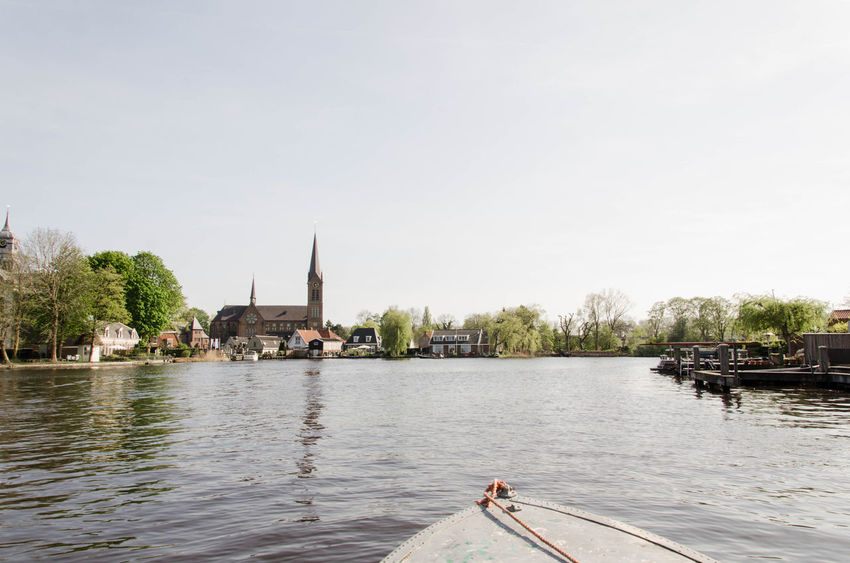 Ouderk Old Town, view from water, canal boating, Amsterdam, Amstel, Netherlands Amstel Amsterdam Amsterdam Canal Netherlands Architecture Boat Boatinglife Building Exterior Built Structure Nature Oude Kerk Outdoors River Sky View From Boat Water