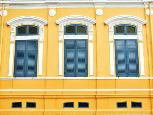 Three windows of the old European-style building. Ancient Arch Architecture Blule Building Exterior Built Structure City Classic Contemporary Day European Style Low Angle View Molding No People Outdoors Outlet Symmetry Ventilate Wall Decoration White Color Window Window Frame Yellow