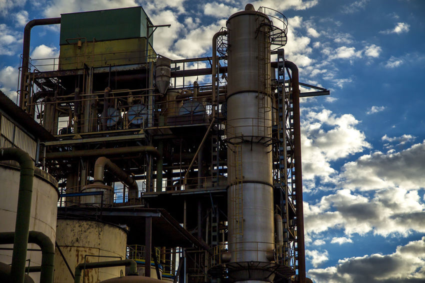 Destillery Alcohol Architecture Building Exterior Built Structure Chemical Plant Cloud - Sky Day Factory Fuel And Power Generation Industrial Building  Industrial Equipment Industry Low Angle View Machinery Metal Metal Industry Nature No People Oil Industry Outdoors Pipe - Tube Refinery Sky Sugar Cane