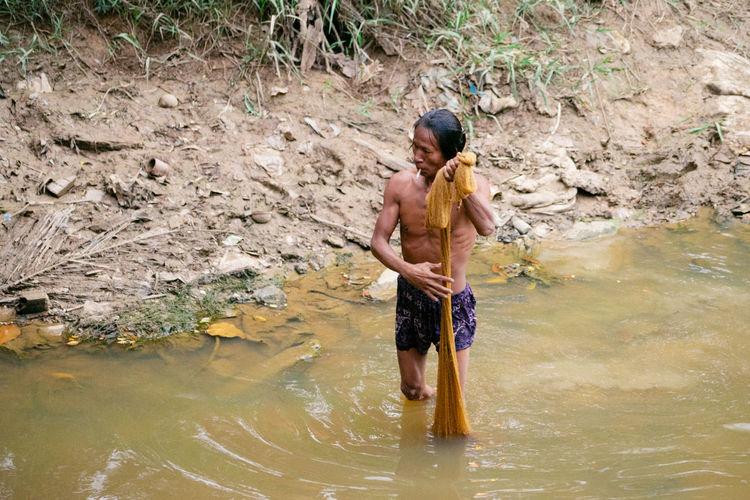 Cambodians Catching A Show Fishing Net Rain River Smoking