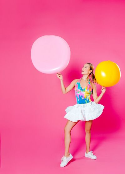 Oh what a colorful day. Goodfeelography Makeportraits Colorsplash EyeEm Selects Pink Color Balloon Full Length Colored Background One Person Studio Shot Pink Background One Woman Only Multi Colored Blond Hair People Portrait Only Women One Young Woman Only