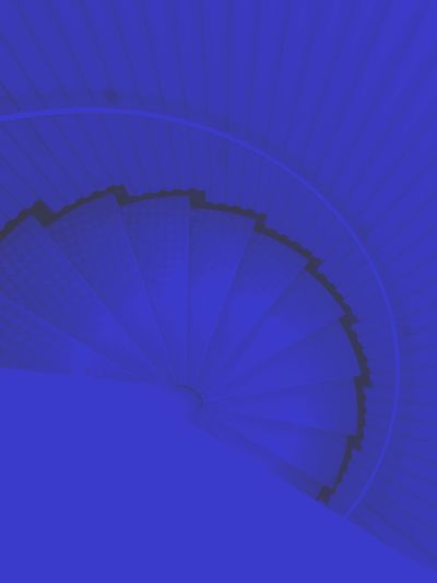 High angle view of blue spiral staircase