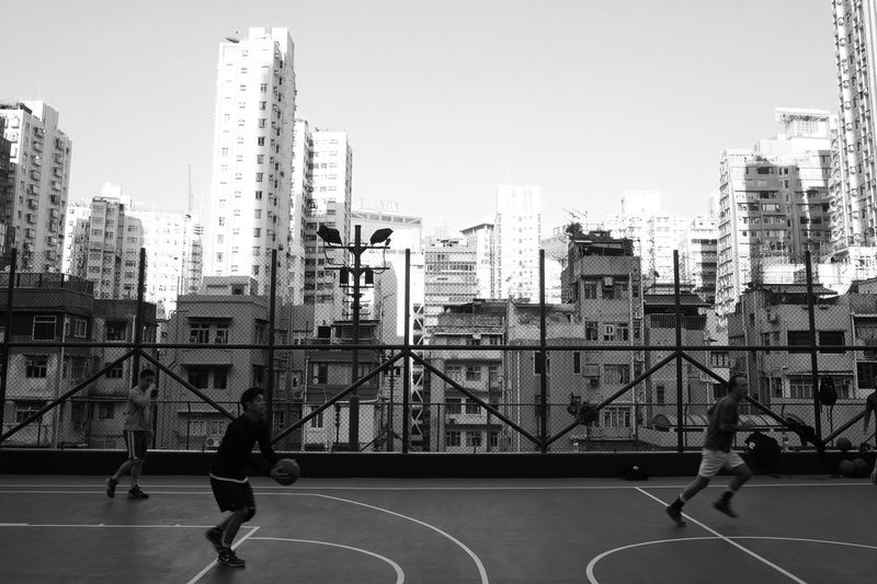 Basketball amongst the high rises, Sheung Wan, Hong Kong. HongKong Streetphotography Black And White Monochrome