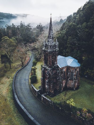 The forgotten church Azores Portugal Winter Landscape VSCO Nature Built Structure Architecture Sky Nature Plant Day Religion Building Exterior Tree No People Place Of Worship Belief Spirituality Outdoors Building Travel Destinations Travel Tower Tourism Spire