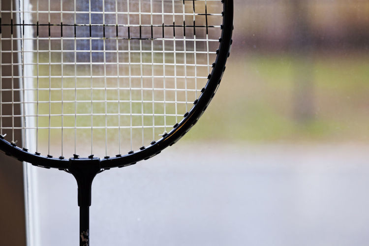 Badminton racket standing in the window with blurry background