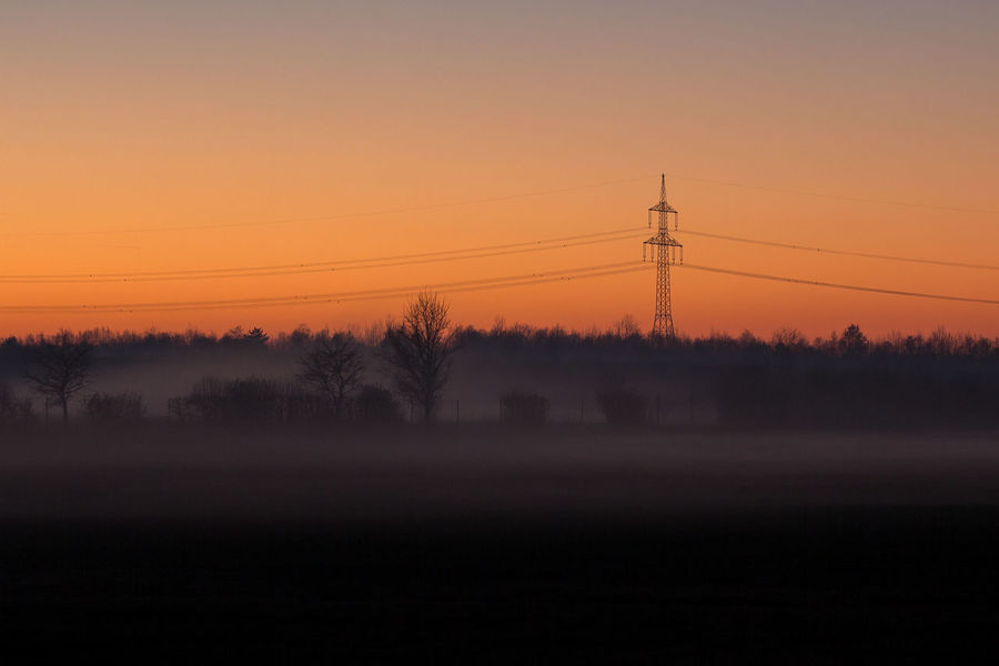 #awesoemoment #burningsky #clearsky #Coldoutside #foggy #sunset #sun #clouds #skylovers #sky #nature #beautifulinnature #naturalbeauty #photography #landscape Fog Landscape Nature No People Outdoors Silhouette Sky Sunset