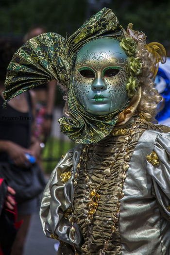 Person In Costume Wearing Venetian Mask During Carnival