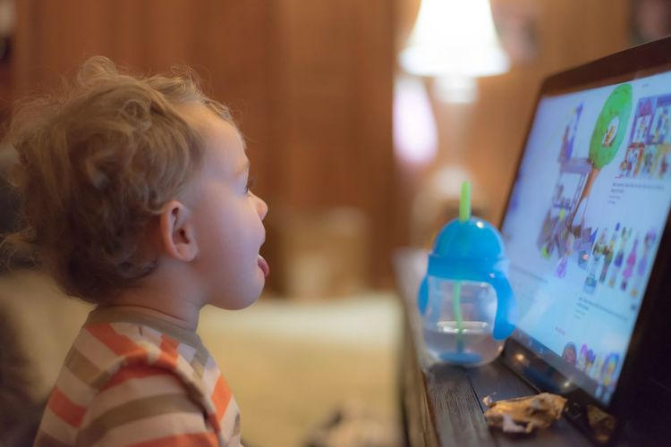 Toddler watching a video Childhood Watching Youtube Tablet Technology Children Photography Watching A Movie Indoors  Real People One Person Childhood Focus On Foreground Boys Side View Blond Hair Lifestyles Headshot Close-up