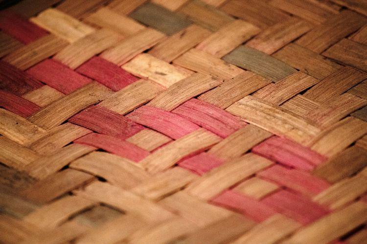 Full frame shot of wicker basket on hardwood floor