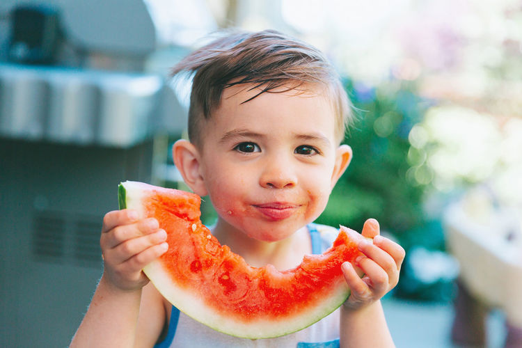 A little boy eating a big piece of watermelon. Food Healthy Eating Fruit Freshness Childhood Portrait Child Holding Watermelon Eating Hungry Real People Boy Smiling Summer