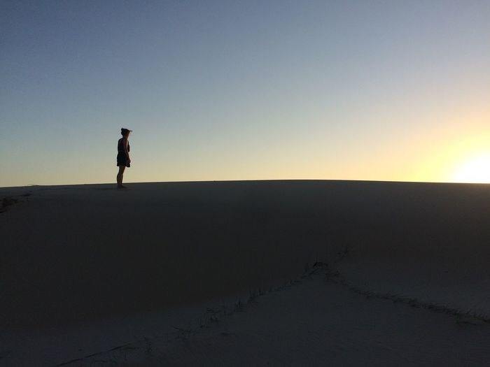 Silhouette Tranquil Scene Standing Landscape Copy Space Scenics Leisure Activity Clear Sky Sunset Human Lifestyles Beauty In Nature Nature Australia Sand Dunes Sunset Silhouettes Getting Away From It All Remote Vacations Idyllic Horizon