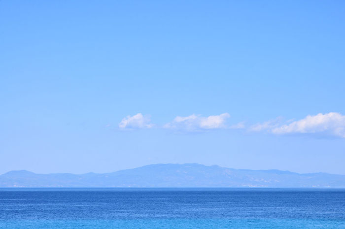 Deep blue sea in Greek Mediterranean. Beauty In Nature Blue Blue Background Blue Only Blue Sea Blue Sky White Clouds Deep Blue Deep Blue Sea Horizon Over Water Idyllic Landscape Light Clouds Mediterranean  Scenics Sea Sea Theme Tranquil Scene Tranquility Turquoise Turquoise Sea Turquoise Water
