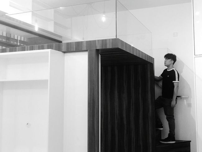 My Son checking out the Platform Bed in the Studio Apartment . Design Interior Streetphotography Sg_streetphotography Singapore Streetphotography Bnwphotography Bnw Bnwsingapore Bnwstreetphotography Singapore
