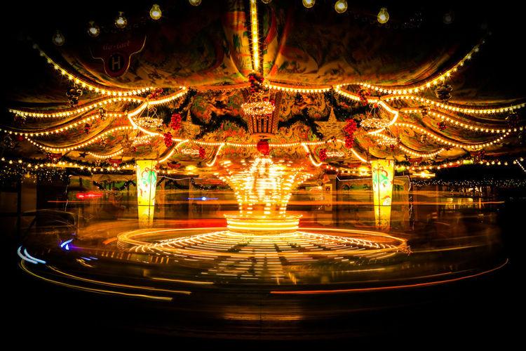 Long Exposure Shot Amusement Park Amusement Park Ride Arts Culture And Entertainment Carousel Clear Sky Illuminated Long Exposure Merry-go-round Night No People Outdoors Sky
