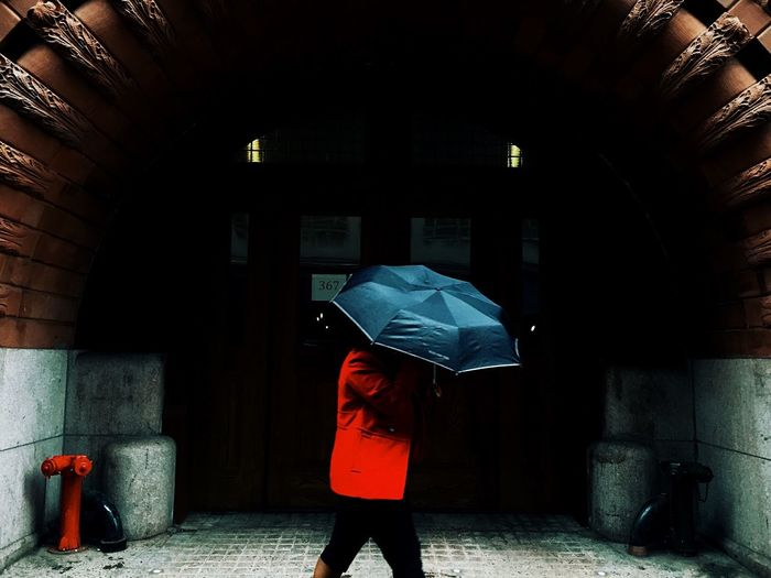 Man Walking With Umbrella In Rain