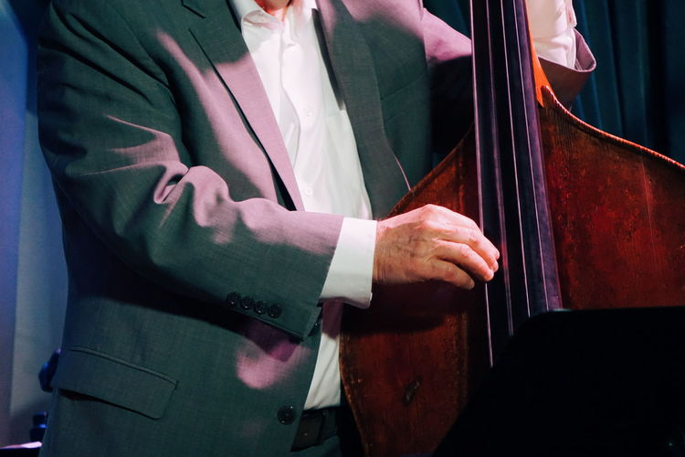Midsection Of Musician Playing Double Bass