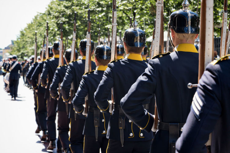 changing of the guards in Stockholm a summer day Adult Adults Only Coordination Group Of People In A Row Keep Pace Large Group Of People Men Men And Women Military Parade Outdoors People Real People Rear View Rifles Uniform Walk In Step Women