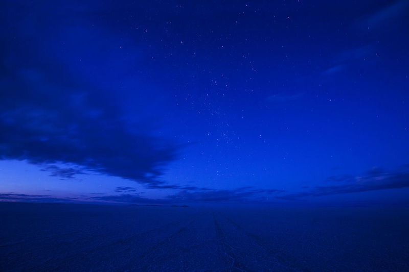 Nightfall over Uyuni Salt Lake Bolivia Altiplano Astronomy Beauty In Nature Blue Blue Night Galaxy Infinity Landscape Mystical Atmosphere Nature Night No People Outdoors Road Salt Flat Salt Lake Scenics Sky Space Star - Space Stars The Way Forward Tranquil Scene Tranquility