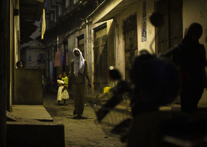 People walking on street at night