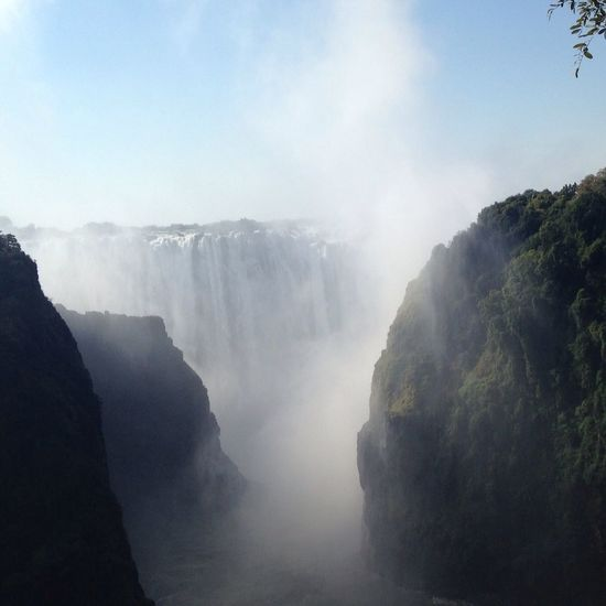 Victoriafalls Nature Scenics Tranquility Beauty In Nature Tourism Fog Idyllic Mountain Tranquil Scene Landscape Waterfall Water No People Day Outdoors Sky