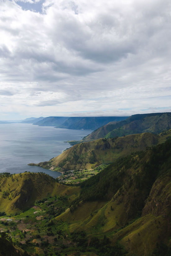 Landscape Cloud - Sky Scenics Outdoors No People Beauty In Nature Day Tranquility Rural Scene Mountain Nature Sky Tree INDONESIA Travel Mountain Range Danau Toba Travel Destinations