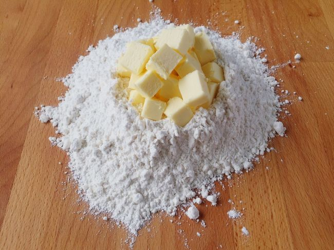 Flour Butter Baking Ingredient Preparation  Table Freshness Close-up Food And Drink Food Indoors  SLICE Meal Ready-to-eat Indulgence Overhead View Beauty In Nature Dessert Dough Knead Mixing Dust Wooden Directly Above Freshness