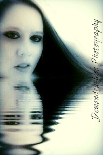 The mysterious woman in the water....Intense... alluring... a siren beckoning... Will you answer the call?