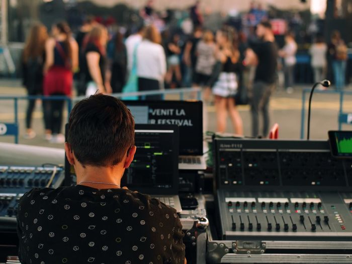 Rear View Of Dj Playing Music At Concert