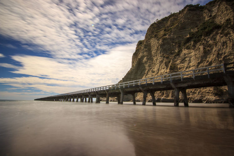 Bridge Bridgephotography Clouds Clouds And Sky Coast Coastline Coastline Landscape Longexposure Longexposure Shot Longexposurephotography Mountain Newzealand Newzealandbeauty Newzealandguide Newzealandnatural Newzealandoutdoors Newzealandphotography Newzealandscenary Ocean Pier Rock Sea Shore Smooth Water