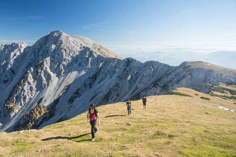 Vajnez, Weinasch, mountain on boardere of Slovenia and Austria Austria Slovenia Beauty In Nature Day Environment Full Length Landscape Leisure Activity Lifestyles Mountain Mountain Range Nature Non-urban Scene One Person Outdoors Real People Rear View Scenics - Nature Sky Standing Tranquil Scene Women