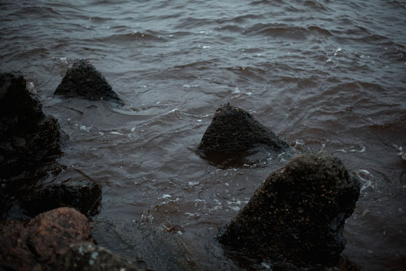 Water Rock Sea Solid Rock - Object Motion High Angle View No People Nature Sport Beach Wave Day Land Aquatic Sport Outdoors Beauty In Nature Tranquility Flowing Water Breaking