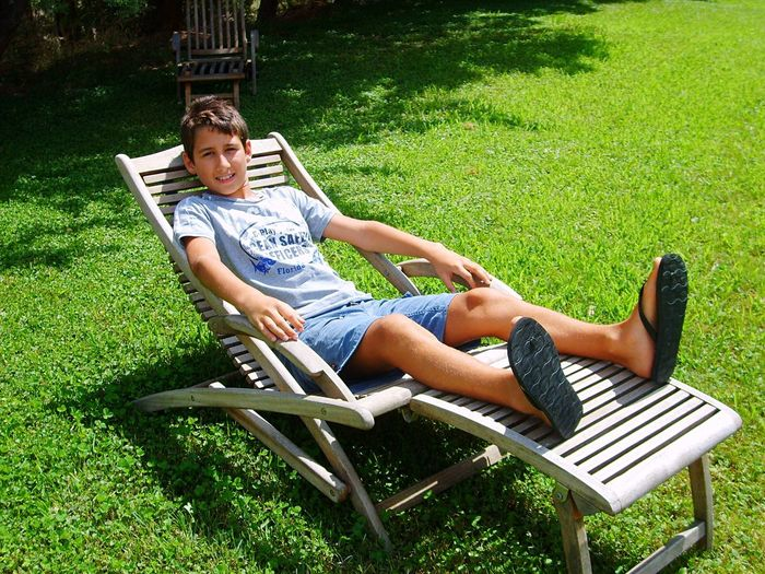 Grass Relaxing Moments When I Was Young 12 Years Old Maremma Grosseto Podere Castellaccia Chair Toscana Estate 2006 Tuscany Young Happiness Looking At Camera Outdoors Little Boy People Summer Summertime Young Boy Sunlight Sunshine Sun ☀