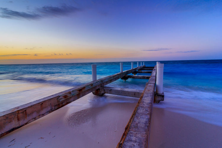 Pier located in Grace Bay, Provienciales, Turks & Caicos Beach Beauty In Nature Blue Day Golden Hour Horizon Over Water Nature No People Outdoors Pier Sand Scenics Sea Sky Sunset Sunset_collection Sunsets Tranquil Scene Tranquility Turks And Caicos Vacations Water Wave
