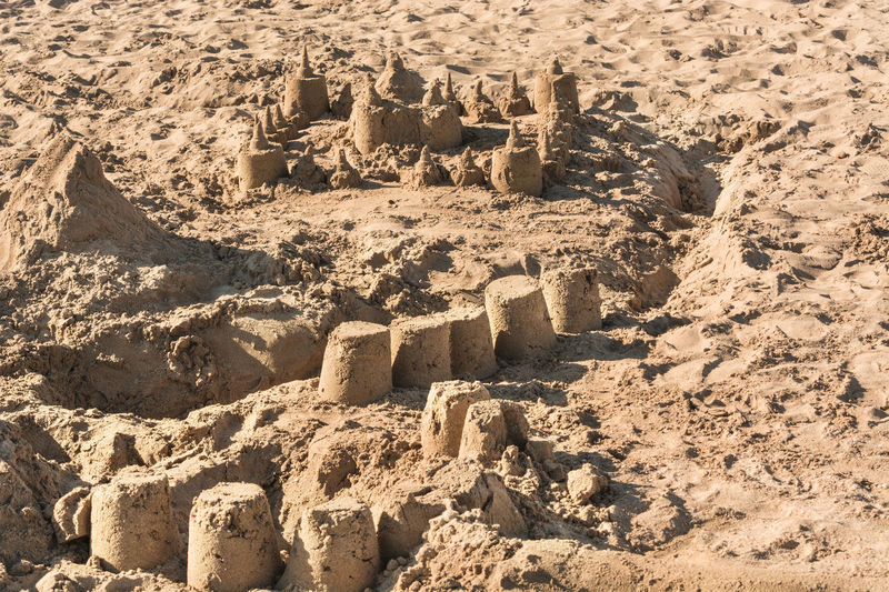 Full frame shot of sandcastles at beach