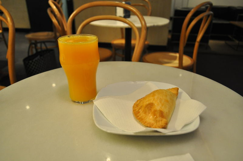 High angle view of empanada with drink served on table in restaurant