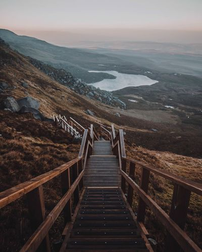 Stairway to Heaven Scenics - Nature Scenics Northern Ireland Canon VSCO Moody Climbing Dusk Sunset Lake Stairway EyeEmNewHere EyeEm Best Shots EyeEm Explore Adventure Hike Hiking Viewpoint Irelandinspires Ireland🍀 Ireland Landscape Nature Beauty In Nature Sky Mountain No People Outdoors Land