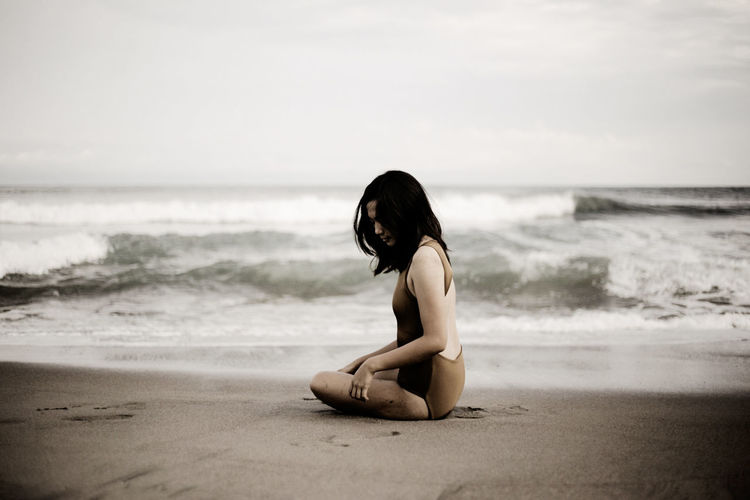 EyeEm Selects Wave Sea Beach Sitting Sand Water Full Length Young Women Relaxation Summer Human Back Tide Low Tide Seascape Calm Shoulder Coastal Feature Coast Surf Back
