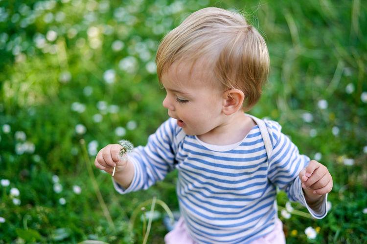 Cute boy against plants