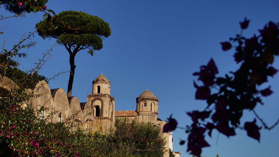 Low angle view of historical building against blue sky at ravello