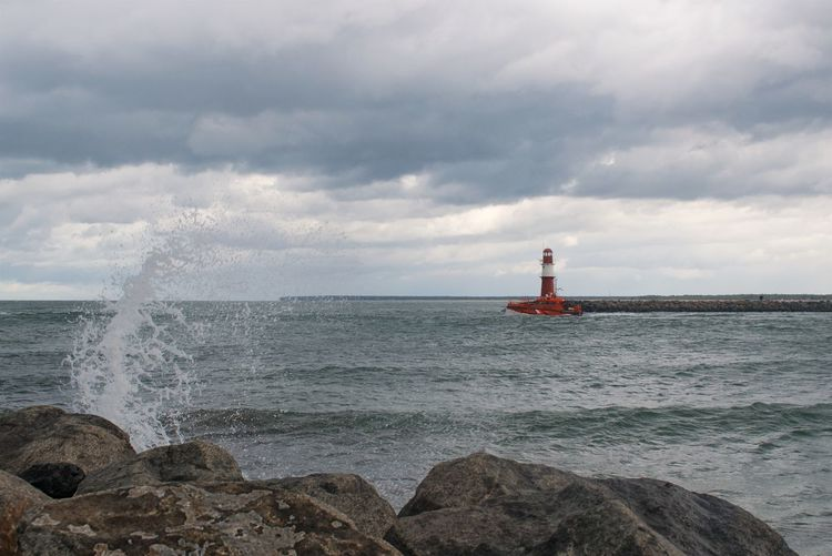 Water Sea Sky Cloud - Sky Guidance Rock Lighthouse Rock - Object Horizon Safety Solid Nature Beauty In Nature Horizon Over Water Tower Scenics - Nature Day Motion Wave Outdoors Lighthouse Pier Pilot Boat