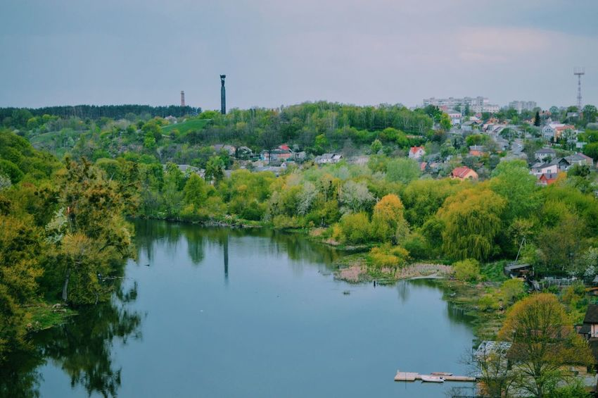 Tree Water Town Sky Green Color Waterfront Beauty In Nature Nature Day Outdoors Non-urban Scene