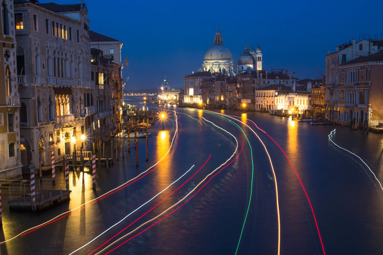 High angle view of light trails on canal at night