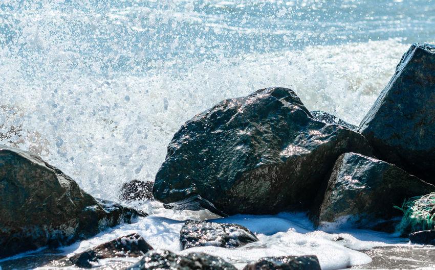 Sea waves splashing on rocks
