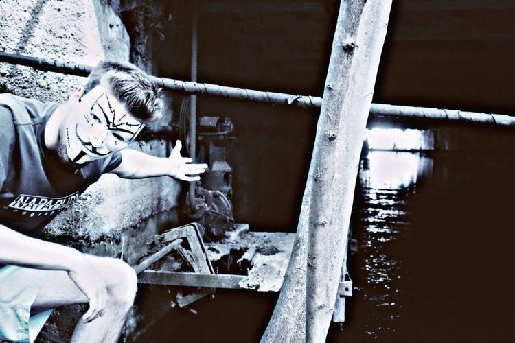 Man holding metal railing