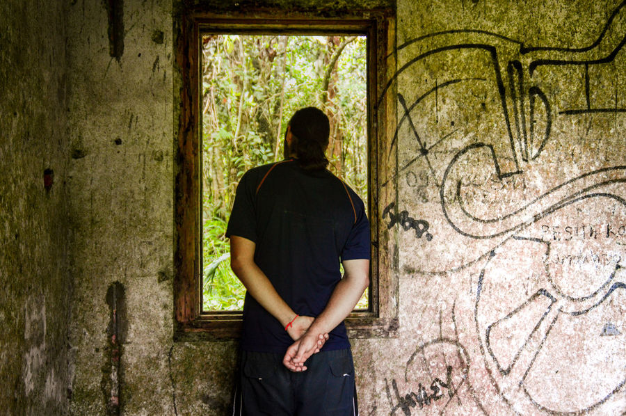 One Person People Casual Clothing Abandoned Places Looking Out The Window Window Frame Lifestyles Real People Architecture Graffiti Abandoned & Derelict Standing Depression - Sadness Mental Health  Agoraphobia Alone Solitude Human Emotions Conceptual Photography