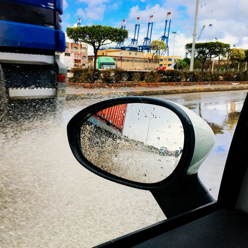 Building Exterior Car Car Interior Close-up Drop Land Vehicle Mode Of Transport Outdoors Rainy Season Reflection Side Mirror Side Window Side-view Mirror Splash Splashing Transportation Vehicle Mirror Water Water Splash Water Splashing Wet Winter Driving Wet Day Side View Water Drop
